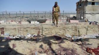 Taliban guard at Kabul airport bombing site