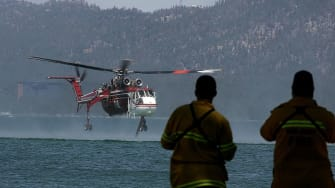 Helicopter scoops water from Lake Tahoe