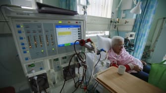 A person receives dialysis treatment.