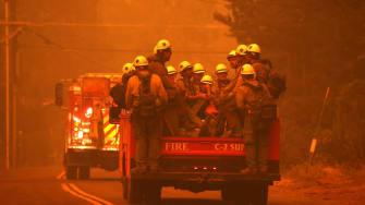 Firefighters battling the Caldor Fire.