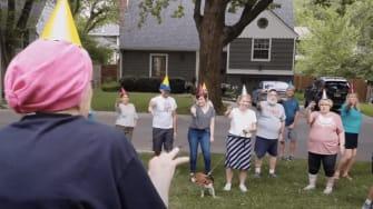 Phyllis Brinkerhoff is greeted by a Hokey Pokey flash mob.