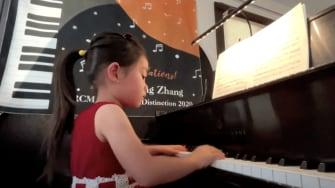 Brigitte Xie playing the piano.