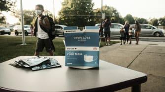 Box of face masks outside school.