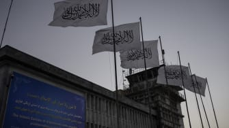 Taliban flags.