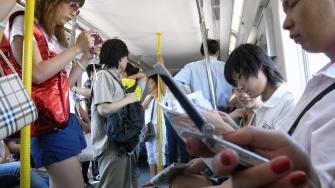 People check phones in Beijing