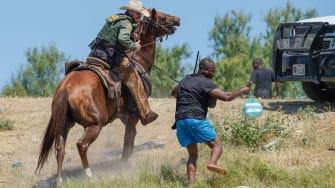 Border Patrol agent and Haitian migrant