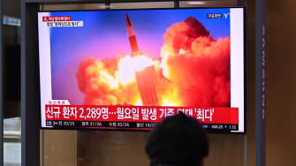 File footage of a North Korean missile launch airs on South Korean TV.