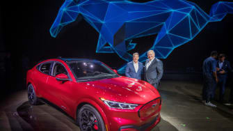 Ford's CEO with an electric car