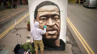 A British artist creates a mural of George Floyd.