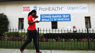 A person walks by a COVID-19 rapid testing center.