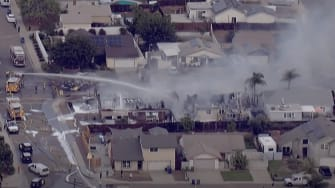 The site of a small plane crash in Santee, California.