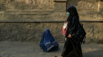 Woman begging in Kabul