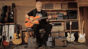 Randy Bachman playing a guitar.