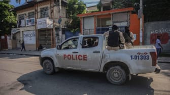 Police truck drives in Haiti