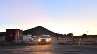 Cop car leaving Bonanza Creek Ranch.