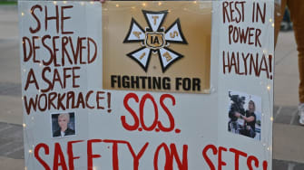 A poster protesting the death of Halyna Hutchins.