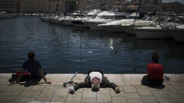 A man sunbathing.
