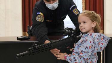 A girl with a gun.