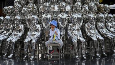 A boy and sculptures.