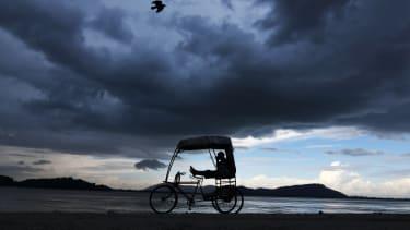 A rickshaw puller.
