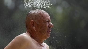 A man taking a shower.