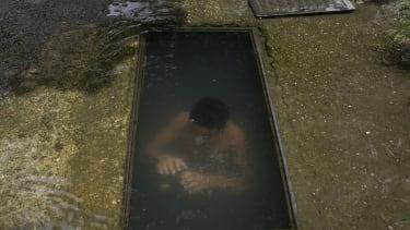 A boy in water.