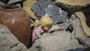 A doll in rubble.