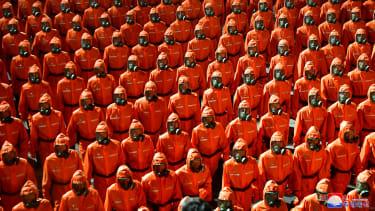 People in hazmat suits.