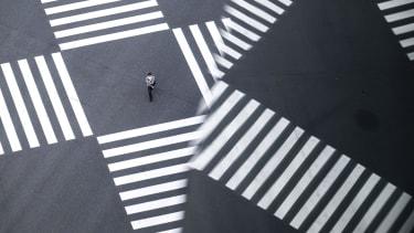 A man crossing a street.
