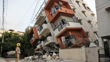 A collapsed apartment building.