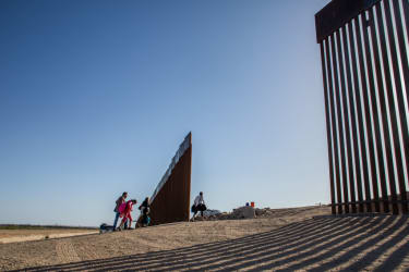A family crosses the border into the United States.
