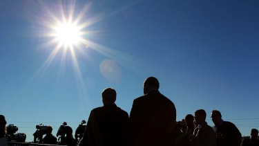 The sun blazes over a crowd in Australia.