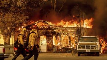 A house burns in Doyle, California.
