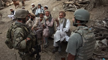 An Afghan interpreter works with a U.S. soldier in 2008.