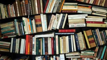 A lot of books on a shelf.