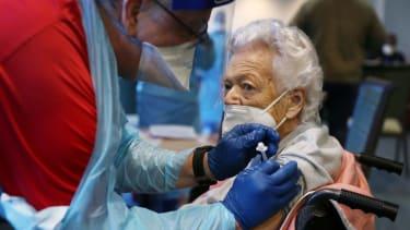 A Florida nursing home resident gets a COVID-19 shot.