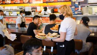Waitress serves food.