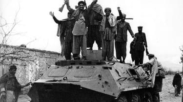 Afghans cheer atop captured Soviet tank