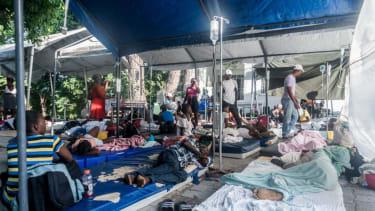 Tents set up outside of a Haitian hospital.