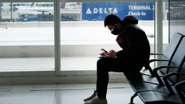 A man wears a mask at JFK Airport in New York City.