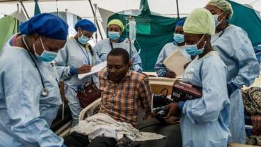Doctors treat a patient in Haiti.