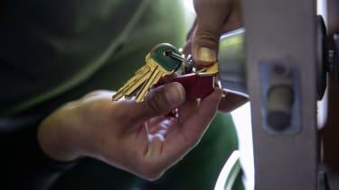 Man holding apartment keys.