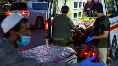 Medical staff bring injured man to a hospital in Kabul