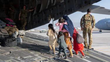 U.S. soldier & Afghan civilians.