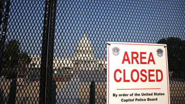 Fenced-in Capitol building.