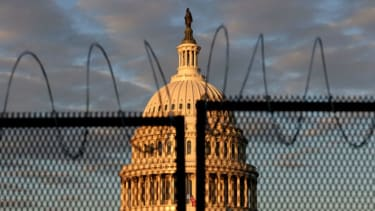 The Capitol building behind a fence.