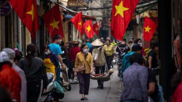 People wearing masks in Hanoi.