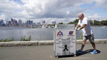 Paul Veneto pushes his beverage cart.