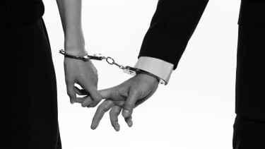 A couple in handcuffs.