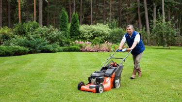 A man mowing the lawn.